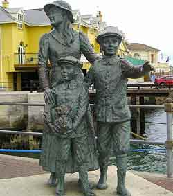 Statue of Annie Moore with her brothers, Cobh, Co Cork. Photo Copyright - Bkkbrad CC3