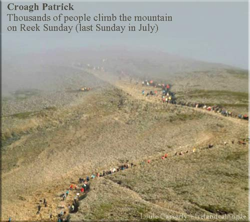 pilgrims-on-summit-ascending-as-a-cloud-covered-top-of-mountain-taken-at-6-am-on-Reek-Croagh-Patrick_Louie-Casserly